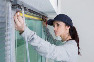 women measuring window for bespoke blinds
